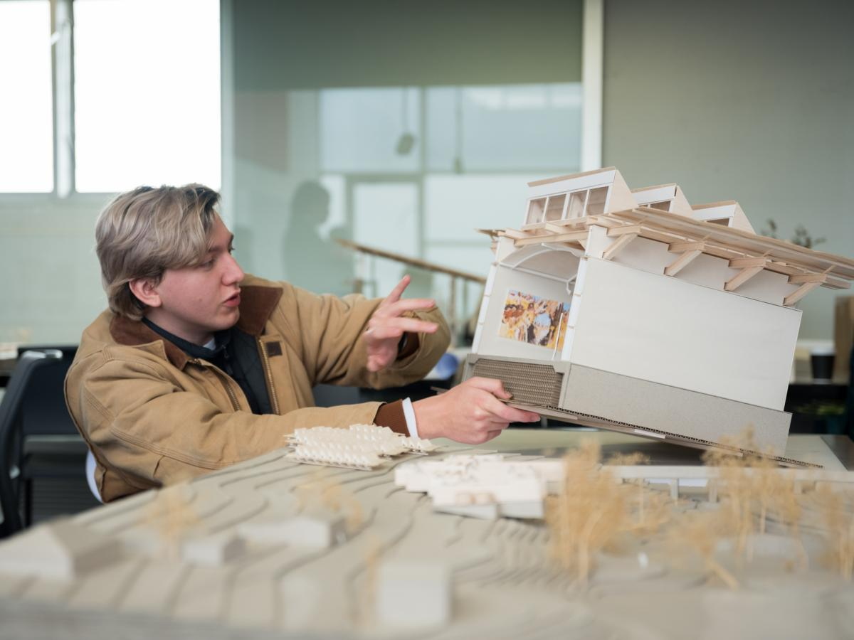 UNSW Architecture student with model