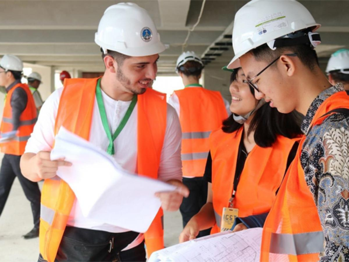 Construction workers reviewing paperwork