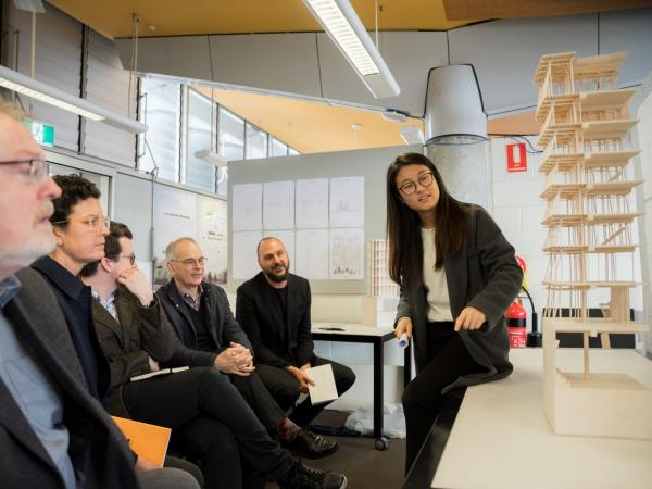 UNSW Architecture student presenting a model
