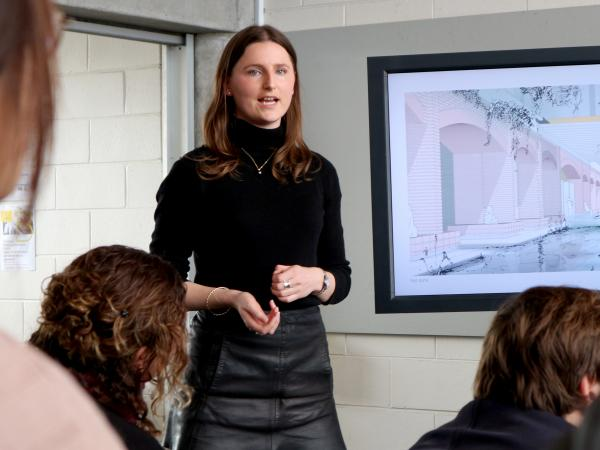 A UNSW City Planning student presenting to a class