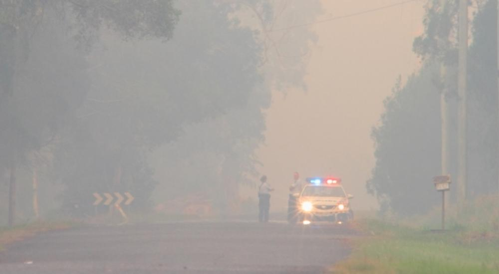 police car in bushfire smoked