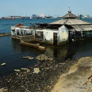 A mosque sinking by polluted water and abrasion in Jakarta, Indonesia