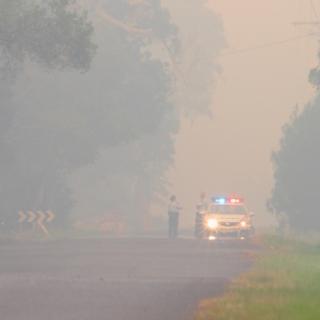 police car in bushfire smoked