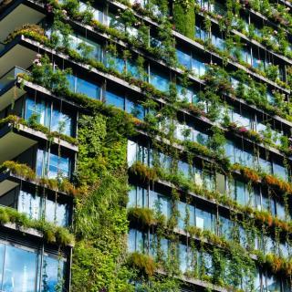 Skyscraper apartment building with vertical garden running down the facade